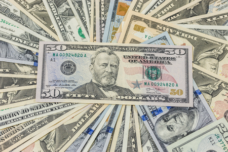 fifty dollar bill: dollars pile as background Stock Photo
