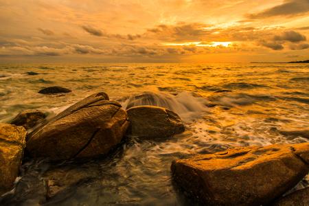 Rocks sea sunset