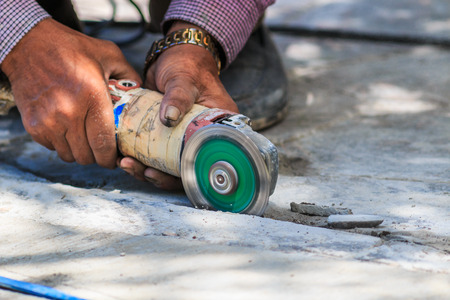 cut off saw: plasterer concrete worker smooth the cement