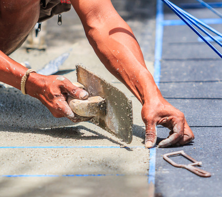 plasterer concrete worker smooth the cement photo