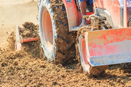furrow: Tractor plows a field shoveling