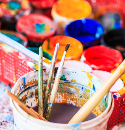 art therapy: Old paints artists paintbrushes paints and brushes background