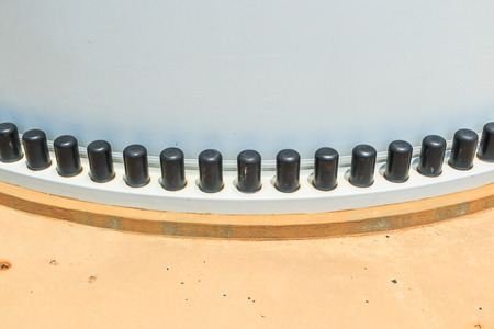 joint of two flanges by bolts and nuts - Plastic screw cap photo