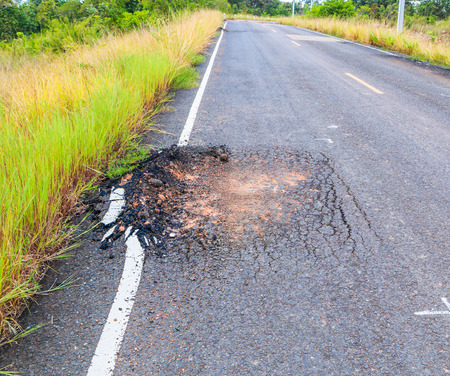 damage control: damaged road Road to Ruin cracked asphalt