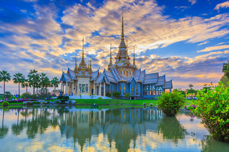 restrict: Wat thai, sunset in temple Thailand,They are public domain or treasure of Buddhism, no restrict in copy or use Stock Photo