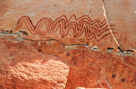 national park: Abstract human art at Pha Taem prehistoric cliff painting which date back three thousands to four thousands years before history,Pha Taem National Park Ubon Ratchathani (Ubolratchathani) Thailand