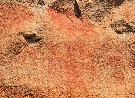 Abstract human art at Pha Taem prehistoric cliff painting which date back three thousands to four thousands years before history,Pha Taem National Park Ubon Ratchathani (Ubolratchathani) Thailand
