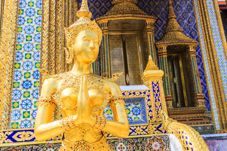 telamon: Golden Kinnari statue at Temple of Emerald Buddha (Wat Phra Kaew) in Grand Royal Palace. Half-bird, half-woman creature at south-east Asian Buddhist mythology. Bangkok, Thailand