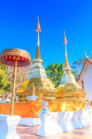public domain: Temple two golden pagoda or stupa Wat Phra That Doi Tung Mae Sai Chiang Rai Thailand They are public domain or treasure of Buddhism no restrict in copy or use