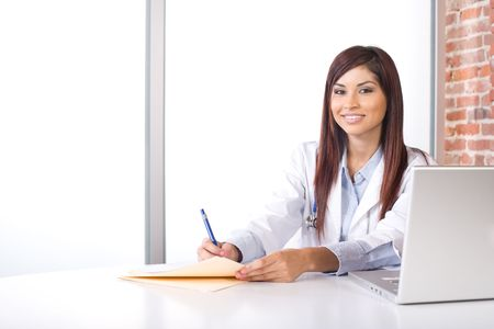 Woman doctor holding a chart in a modern office photo