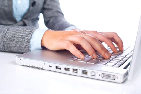 Person Typing on a modern laptop in an office Stock Photo