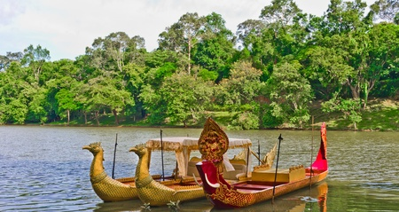 Traditional cambodian boats by the river Bayon - Angkor, Cambodia, Southeast Asia