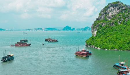 Boat traffic in Halong Bay, Vietnam, Southeast Asia Stock Photo