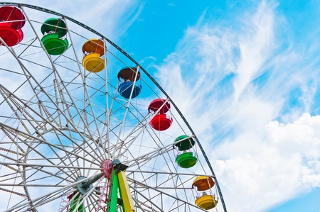 Colorful ferris wheel on blue sky background, Moscow, Russia, East Europe photo