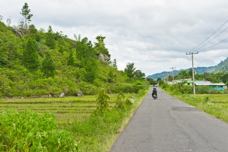 View of road in Sumatra, Indonesia, Southeast Asia Stock Photo