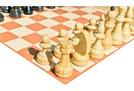 Chess pieces on board isolated on white background photo