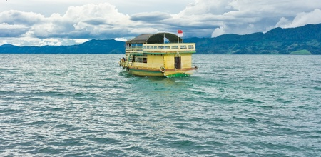 Cruise on Lake Toba in Sumatra, Indonesia. It is the largest and deepest volcanic crater lake in the world. photo