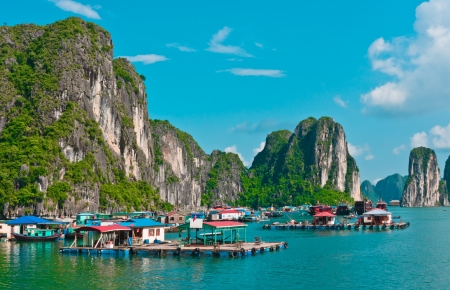View of floating village in Halong Bay, Vietnam, Southeast Asia Stock Photo