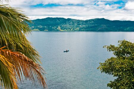 Fisherman on Lake Toba, Sumatra, Indonesia, Southeast Asia   It is the largest and deepest volcanic crater lake in the world  photo