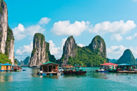 Floating village and rock islands in Halong Bay, Vietnam, Southeast Asia photo