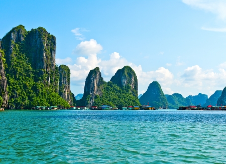 View of floating village and rock islands in Halong Bay, Vietnam, Southeast Asia Stock Photo