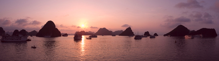 Purple sunset in Halong Bay, Vietnam, Southeast Asia Stock Photo