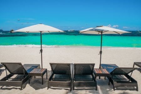 Beach umbrellas and loungers on perfect white beach, Boracay, Philippines
