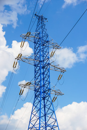 power line tower: Power line tower on blue sky background Stock Photo