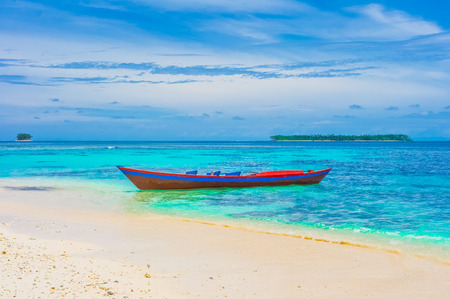 desert water: Tropical landscape with islands and lonely boat, Indonesia, Southeast Asia Stock Photo