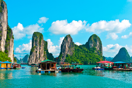 the bay: Floating village and rock islands in Halong Bay, Vietnam, Southeast Asia
