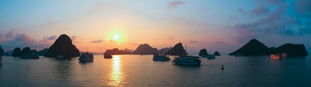 panoramic view: Panoramic view of sunset in Halong Bay, Vietnam, Southeast Asia Stock Photo