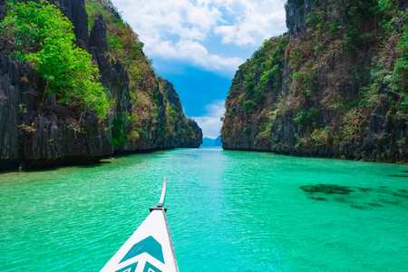 Boat trip in blue lagoon, Palawan, Philippines