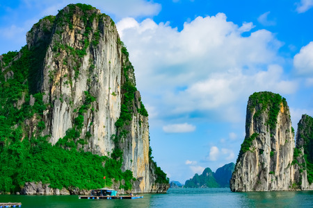 Rock islands near floating village in Halong Bay, Vietnam, Southeast Asia