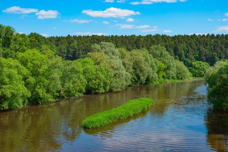 Summer landscape with river, forest, sky and clouds Stock Photo