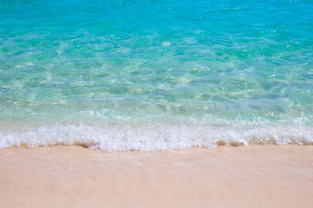Tropical sand beach and blue sea wave Stock Photo