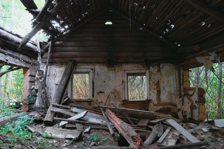 abandoned room: Ruins of old abandoned wooden house. Destroyed room with windows.