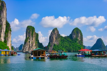 Floating village and rock islands in Halong Bay, Vietnam, Southeast Asia. UNESCO World Heritage Site.