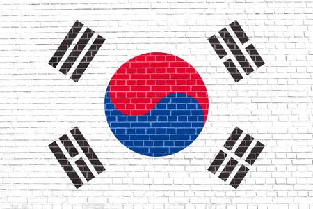 korean national: Flag of South Korea on brick wall texture background. South Korean national flag.