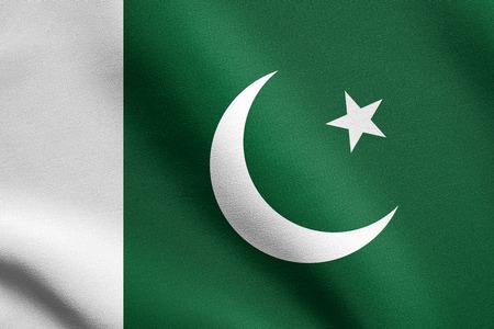 pakistani pakistan: Flag of Pakistan waving in the wind with detailed fabric texture. Pakistani national flag. Stock Photo