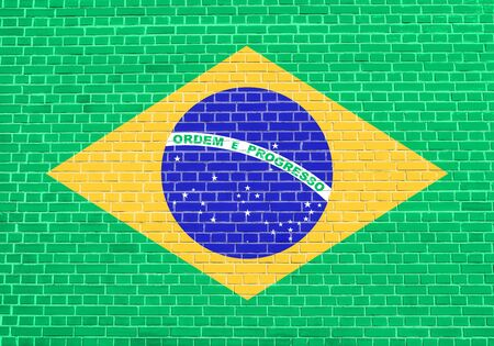 Flag of Brazil on brick wall texture background. Brazilian national flag.
