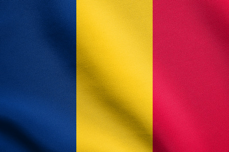 chadian: Chadian national official flag. African patriotic symbol, banner, element, background. Flag of Chad waving in the wind with detailed fabric texture Stock Photo