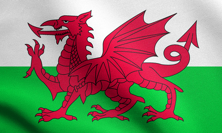 Welsh national official flag. Patriotic symbol, banner, element, background. Flag of Wales waving in the wind with detailed fabric texture