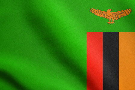 Zambian national official flag. African patriotic symbol, banner, element, background. Accurate dimensions. Correct size, colors. Flag of Zambia waving in the wind with detailed fabric texture Stock Photo