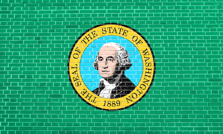solid state: Washingtonian official flag, symbol. American patriotic element. USA banner. United States of America background. Flag of the US state of Washington on brick wall texture background Stock Photo