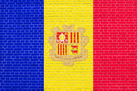 solid state: Andorran national official flag. Patriotic symbol, banner, element, background. Accurate dimensions. Correct size, colors. Flag of Andorra on brick wall texture background