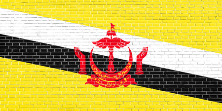 Bruneian national official flag. Patriotic symbol, banner, element, background. Accurate dimensions. Correct size, colors. Flag of Brunei on brick wall texture background Stock Photo