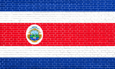 solid state: Costa Rican national official flag. Patriotic symbol, banner, element, background. Accurate dimensions. Correct size, colors. Flag of Costa Rica on brick wall texture background Stock Photo