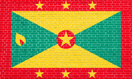 Grenadian national official flag. Patriotic symbol, banner, element, background. Accurate dimensions. Correct size, colors. Flag of Grenada on brick wall texture background Stock Photo