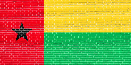 Bissau-Guinean national official flag. African patriotic symbol, banner, element, background. Accurate dimensions. Correct size, colors. Flag of Guinea-Bissau on brick wall texture background