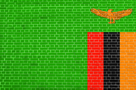 zambian flag: Zambian national official flag. African patriotic symbol, banner, element, background. Accurate dimensions. Correct size, colors. Flag of Zambia on brick wall texture background